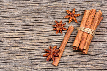 Group of cinnamon sticks with anise star on table