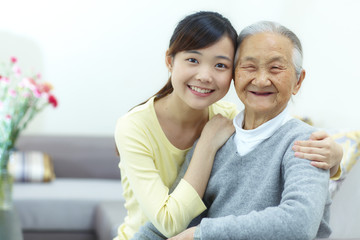 Happy senior woman with her granddaughter