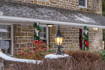 Illuminated outdoor lantern with white snow gives an extra charater for a holiday decor. Holiday concept.