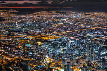 Bogota, Colombia, view of downtown buildings and cityscape illuminated at dusk.