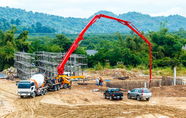 construction building works with concrete pump