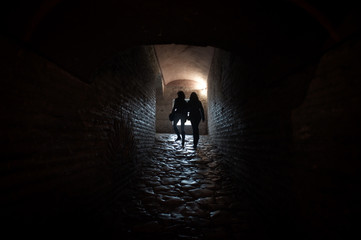Silhouettes in a Passageway