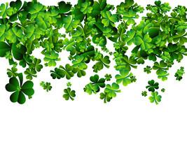 Background with sprayed clover leaves or shamrocks. Saint Patricks day Background.