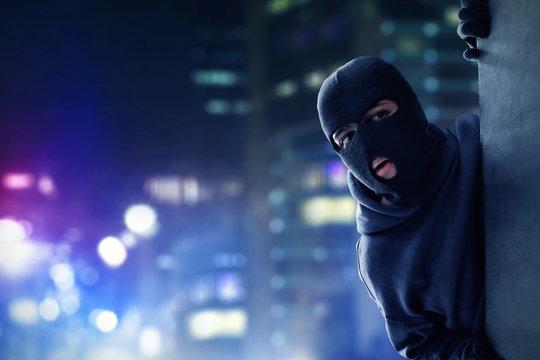 Masked thief hiding