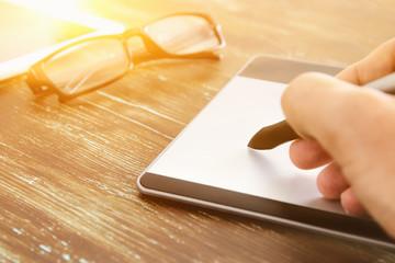Graphic designer working on digital tablet.
