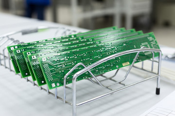 Several ready-made printed circuit boards are installed in a metal stand.