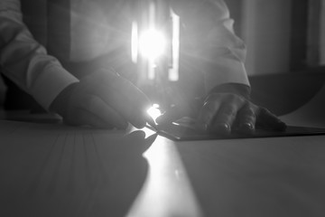 Businessman working backlit by a sunburst
