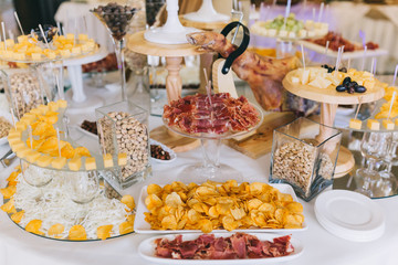 Meat, cheese and nutmeg wedding buffet with various snacks.