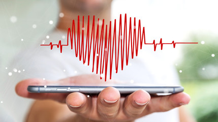 Businessman holding heart beat sketch over mobile phone
