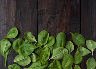 fresh green spinach on vintage wooden texture