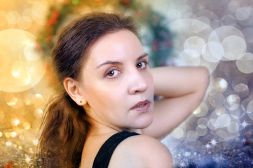 portrait of a beautiful young woman over lights background