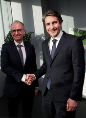 Patrice Caine, Chairman and CEO of Aerospace and defence group Thales, and Philippe Vallee, CEO of chipmaker Gemalto, shake hands before a news conference in Paris