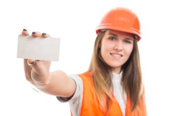 Successful female engineer showing blank visit card