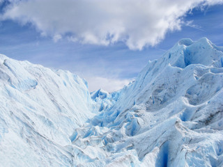 Blue ice background texture. Perito Moreno clear blue glacier close up in Los Glaciares National Park, Patagonia, Argentina, South America. Blue iceberg with Ice caves.
