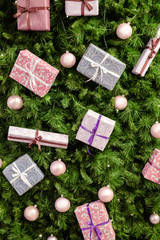 Image of Christmas background with spruce, purple boxes