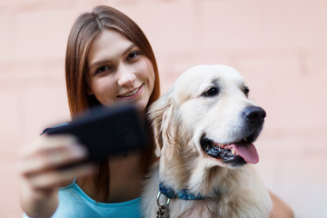 Photo of brunette doing selfie with dog