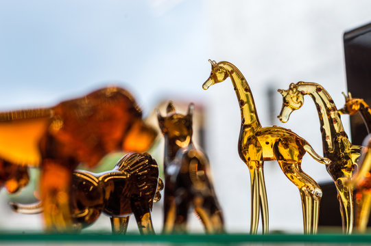 Animal figures made of glass displayed on a shelf of a gift store in Eskisehir