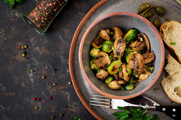 Poster Brussels Vegan dish. Baked mushrooms with Brussels sprouts and herbs. Proper nutrition. Healthy lifestyle. Top view