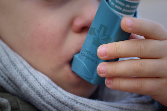 Child trying asthma with cannabis inhaler