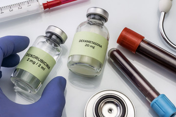 Doctor hold vial of doxorubicina in a hospital. Conceptual image
