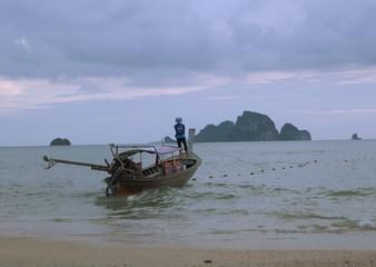 fishermen on asian boat