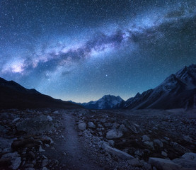 Milky Way and mountains. Fantastic view with mountains and starry sky at night in Nepal. Trail through mountain valley and sky with stars. Beautiful Himalayas. Night landscape with bright milky way