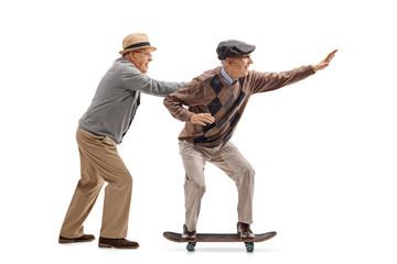 Senior pushing another senior on a skateboard