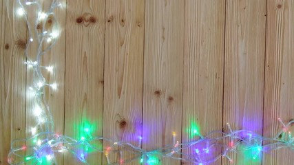 010 fancy blinker light bulbs or garlands and wreath on wood table for christmas or new years