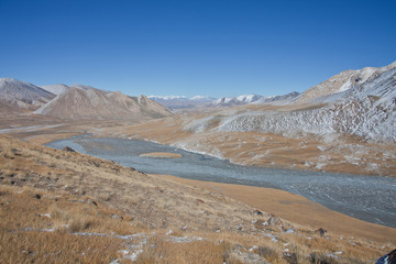 Mountain valley and the source of the river in Tien Shan