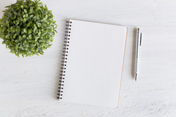 Flat lay photo of office desk on white background,empty notebook open on white wood table