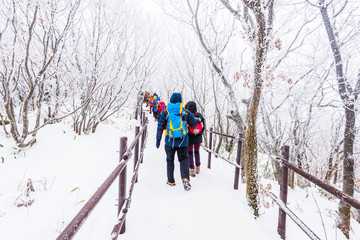 Hiking in the winter with trekking photo .winter mountains landscape snow in korea.