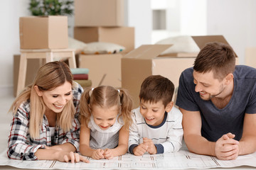 Happy family studying project of new flat