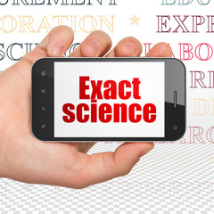 Science concept: Hand Holding Smartphone with  red text Exact Science on display,  Tag Cloud background, 3D rendering