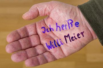 Hand with wrote down names