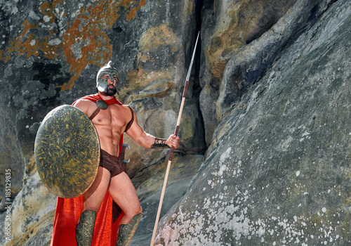 Shot of a brave muscular Spartan warrior with a shield and a