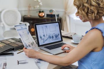 Caucasian woman furniture designer working at her atelier.