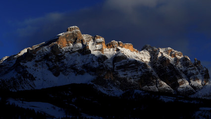 The Dolomite mountains are seen at the sunset in Alta Badia