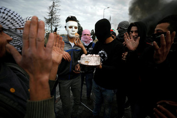 Palestinian demonstrators hold a birthday party during a protest near the Jewish settlement of Beit El near Ramallah