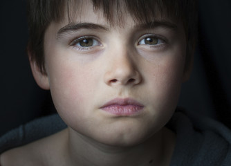 Close-up portrait of confident boy