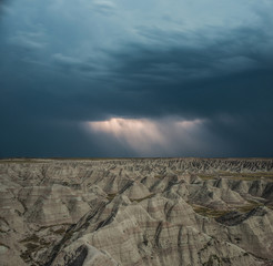 High angle scenic view of rock formations at Badlands National Park against stormy clouds