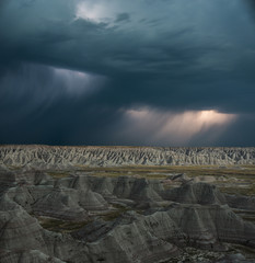 High angle majestic view of rock formations at Badlands National Park against stormy clouds