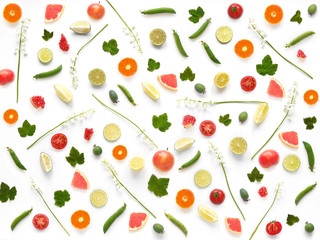 Pattern of of flowers and fruits. Abstract food background, top view, flat lay. Composition of  lily of the valley, currant leaves, tangerines, tomatoes, grapefruit, isolated on white background.