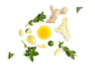 Fototapete - The concept of healthy eating. Vegetables and fruits isolated on white background. Composition from the root of ginger, slices of lemon and lime, leaves of mint, honey, avocado, with copy space.