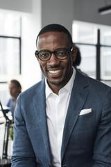 Portrait of happy businessman wearing eyeglasses in office