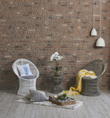 modern brick wall home design wicker chair yellow blanket interior design