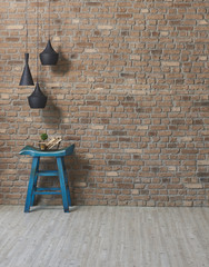 blue chair and black lamp room with brick wall