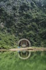 View of tunnel in mountain by lake