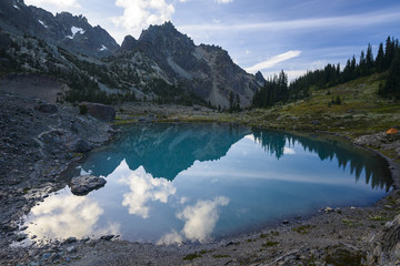 Idyllic view of lake by mountains against sky at Olympic National Park
