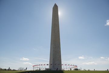 Low angle view of Washington Monument against sky during sunny day