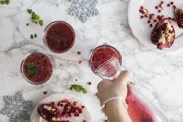 Pomegranate Juice Glasses and Gathering on the Table (Hands)